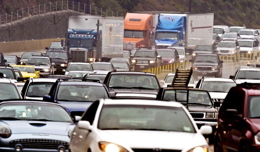 "FILE - In this Dec. 29, 2010 file photo, traffic jams up on the eastbound State Route 91 Freeway near Corona, Calif.  Motorists are warned to avoid State Route 91 in Corona this weekend as all lanes are shut down while crews demolish a bridge as part of a freeway widening project. The 55-hour closure, dubbed ""Coronageddon"" to help get the word out, begins Friday, Feb. 19, 2016, at  9pm for a six-mile stretch between Interstate 15 and State Route 71. Transportation officials hope to have the 91 reopened in time for the Monday morning commute. (Bruce Chambers/Orange County Register via AP, File)  MAGS OUT; LOS ANGELES TIMES OUT"