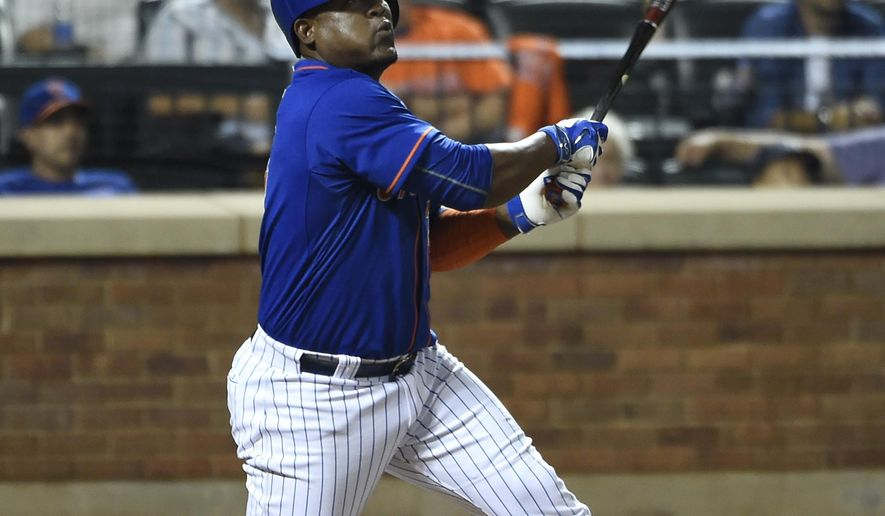 FILE - In this Sept. 18, 2015, file photo, New York Mets' Juan Uribe watches his two-run home run off of New York Yankees relief pitcher Chasen Shreve in the seventh inning of a baseball game, in New York. The Cleveland Indians have agreed to a one-year, $5 million contract with veteran infielder Juan Uribe, who will likely be their starting third baseman this season. The team confirmed on Friday, Feb. 19, 2016, that the 36-year-old will sign once some issues are resolved with his visa and he's able to return to the United States. (AP Photo/Kathy Kmonicek, File)