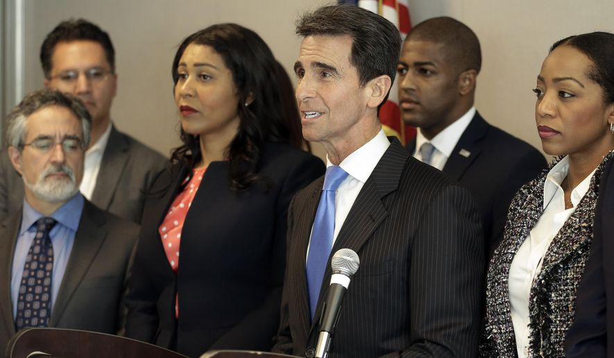 Sen. Mark Leno, D-San Francisco, center, speaks during a media conference Friday, Feb. 19, 2016, in San Francisco. Leno has introduced SB 1286, a bill which would allow greater public access to police officer records related to serious use of force and sustained charges of misconduct. (AP Photo/Ben Margot)