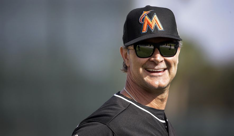 Miami Marlins manager Don Mattingly smiles during spring training baseball practice Friday, Feb. 19, 2016, in Jupiter, Fla. (AP Photo/Jeff Roberson)