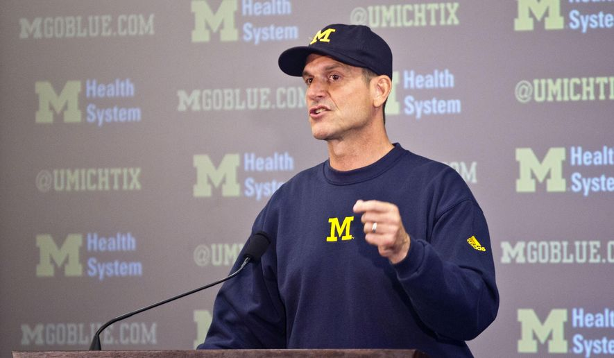 FILE - In this Aug. 6, 2015, file photo, Michigan head coach Jim Harbaugh speaks at a press conference during the NCAA college football team's annual media day in Ann Arbor, Mich. Jim Harbaugh has come up with another way to get in the spotlight. Michigan announced Friday, Feb. 19, 2016,  its spring football game will be at night for the first time on April 1. (AP Photo/Tony Ding, File)