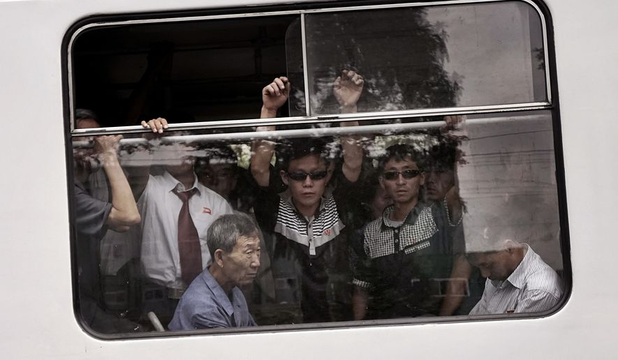 FILE - In this Sept. 11, 2015, file photo, commuters ride on a crowded city trolley bus, in Pyongyang, North Korea. Though dimly aware that more sanctions may be on the way because of the latest nuclear test and rocket launch, most North Koreans seem almost blase about it. Life is much tougher in the countryside and the gap between the haves and the have-nots is hard to ignore even in the capital. Just a few blocks from upscale shops, throngs of city residents stand in long lines to catch the cross-town trolleys or take advantage of the holiday discounts on fish and other foods. (AP Photo/Wong Maye-E, File)