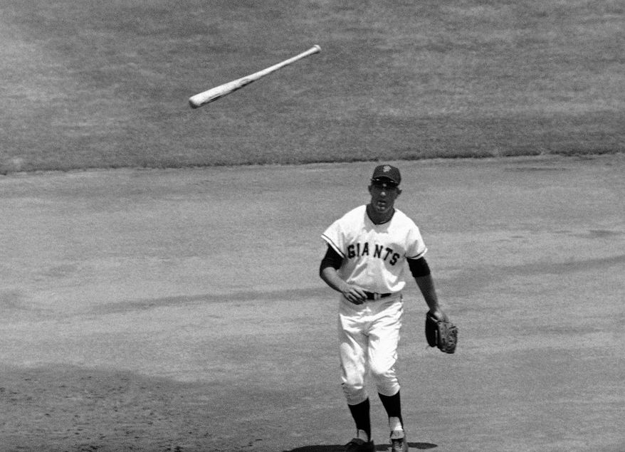 FILE - In this July 16, 1967, file photo, San Francisco Giants third baseman Jim Davenport looks at the bat thrown by Chicago Cubs' Adolfo Phillips in the second inning of  a baseball game in San Francisco. Jim Davenport, a longtime third baseman for the Giants who later managed the team and worked in the front office, has died. He was 82. The Giants announced his death Friday, Feb. 19, 2016, saying he died Thursday night in Redwood City, Calif.,, because of heart failure. (AP Photo/File)