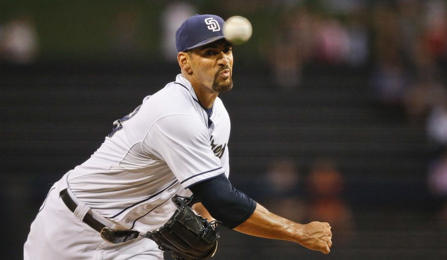 FILe - In this Aug. 31, 2015, file photo, San Diego Padres starting pitcher Tyson Ross works against the Texas Rangers in the first inning of a baseball game, in San Diego. New manager Andy Green has picked Tyson Ross as the opening day starter against the defending NL West champion Los Angeles Dodgers April 4 at Petco Park. (AP Photo/Lenny Ignelzi, File)