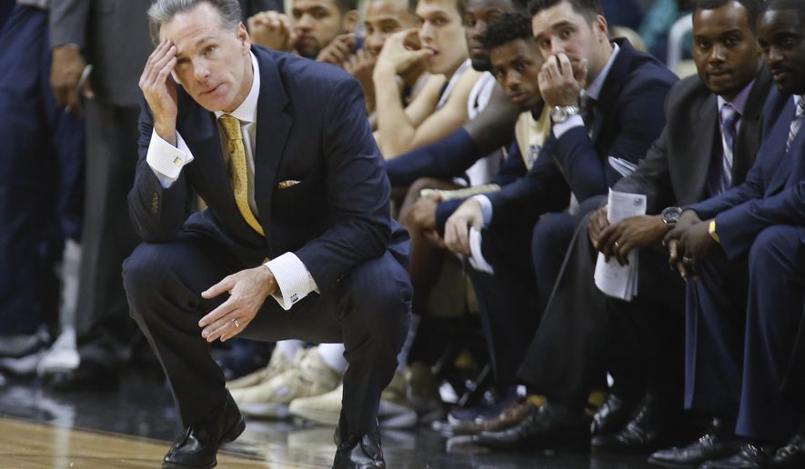 FILE - In this file photo from Dec. 4, 2015, Pittsburgh head coach Jamie Dixon watches his team in an NCAA college basketball game against Duquesne, in Pittsburgh. The Panthers are adrift in the middle of a crowded ACC thanks to an inability to get stops against good teams. Unthinkable for a program that spent the first decade of coach Jamie Dixon's career as one of the toughest schools in the Big East.(AP Photo/Keith Srakocic, FILE)