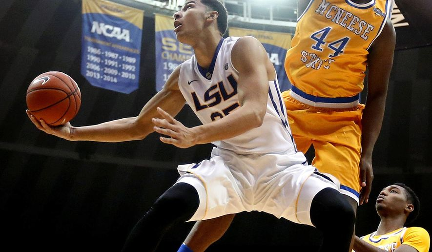 FILE - In this Nov. 13, 2015, file photo, LSU forward Ben Simmons (25) goes to the basket against McNeese State forward Austin Lewis (44) in the second half of an NCAA college basketball game in Baton Rouge, La. The college basketball season is winding toward March Madness and a small group of players established themselves as front-runners to be the national player of the year. (AP Photo/Gerald Herbert, File)