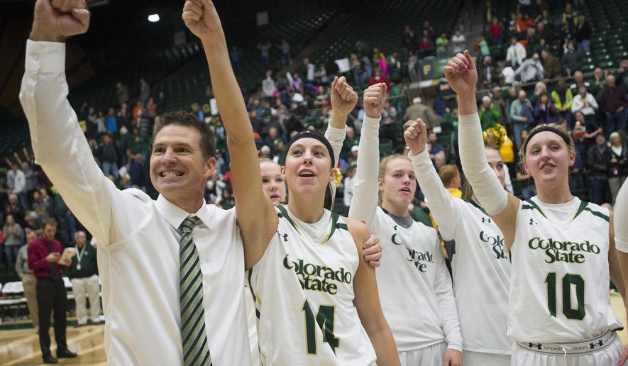 In this Saturday, Nov. 21, 2015, photo, Colorado State coach Ryun Williams and his team celebrate a 61-55 win in an NCA college basketball game against BYU at Moby Arena in Fort Collins, Colo. The Lady Rams have reeled off a school-record 20 straight wins as the team chases an NCAA tournament bid for the first time since 2002. (Austin Humphreys/Fort Collins Coloradoan via AP)