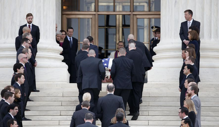 The body of Justice Antonin Scalia arrives at the Supreme Court in Washington, Friday, Feb. 19, 2016. Thousands of mourners will pay their respects Friday for Justice Antonin Scalia as his casket rests in the Great Hall of the Supreme Court, where he spent nearly three decades as one of its most influential members. (AP Photo/Alex Brandon)