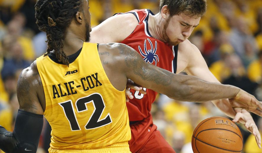 VCU's Mo Alie-Cox (12) and Richmond's T.J. Cline (10) collide during the seconnd half of an NCAA college basketball game in Richmond, Va., Friday, Feb. 19, 2016. (Mark Gormus/Richmond Times-Dispatch via AP) MANDATORY CREDIT