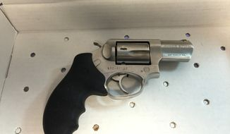 This photo provided by the New York City Police shows a revolver that was found in the front seat of a suspect, who crashed his car into a police vehicle, Saturday, Feb. 20, 2016 in New York. (Photo provided by NYPD via AP)