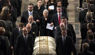 Widow Maureen McCarthy Scalia, walks behind the casket as it is ushered out of the Bascilica following the funeral mass for the late Supreme Court Associate Justice Antonin Scalia, at the Basilica of the National Shrine of the Immaculate Conception in Washington, Saturday, Feb. 20, 2016.  (Doug Mills/The New York Times via AP, Pool)