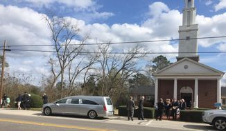 """Friends and family of author Harper Lee leave the First United Methodist Church after a private funeral service, Saturday, Feb. 20, 2016, in Monroeville, Ala.  Lee, the elusive author of best-seller """"To Kill a Mockingbird,"""" died Friday, Feb. 19, according to her publisher Harper Collins. She was 89. (AP Photo/Kim Chandler)"""