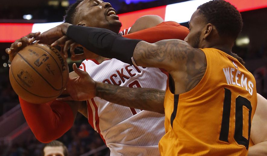 Houston Rockets center Dwight Howard draws the foul on Phoenix Suns guard Sonny Weems (10) in the second quarter during an NBA basketball game, Friday, Feb. 19, 2016, in Phoenix. (AP Photo/Rick Scuteri)