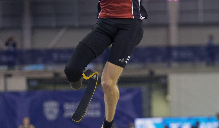 Germany's Markus Rehm in action on his way to winning the men's long jump event during the Glasgow Indoor Grand Prix, at the Emirates Arena, Glasgow, Saturday, Feb. 20, 2016. Paralympic champion Markus Rehm leaped 8.10 meters to win the long jump at the Glasgow Grand Prix on Saturday, boosting his profile while he attempts to prove his eligibility for the Olympic Games this year. (Ian Rutherford/PA via AP) UNITED KINGDOM OUT