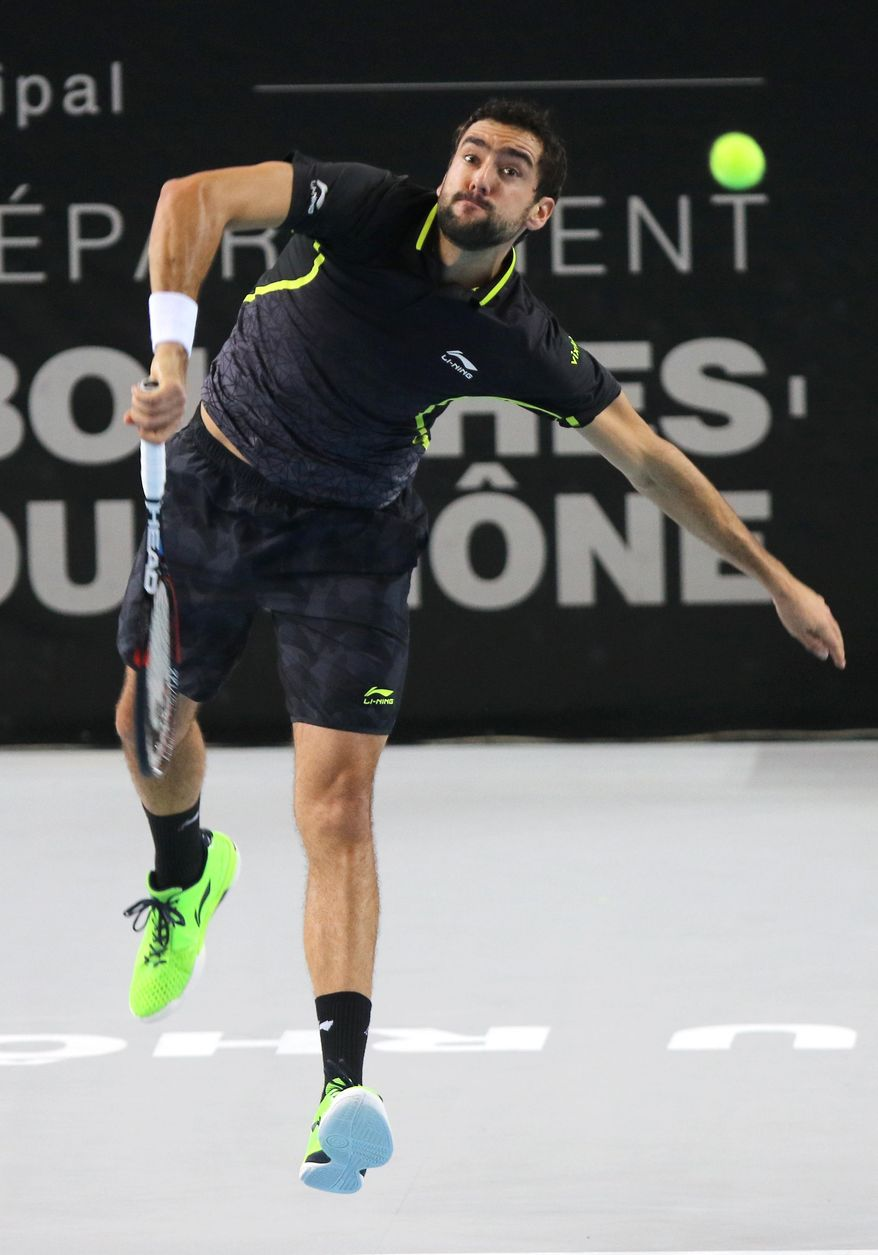 Marin Cilic of Croatia serves the ball to France's Benoit Paire, during their semi finals match, at the Open 13 Provence tennis tournament, in Marseille, southern France, Saturday Feb. 20, 2016.(AP Photo/Claude Paris)