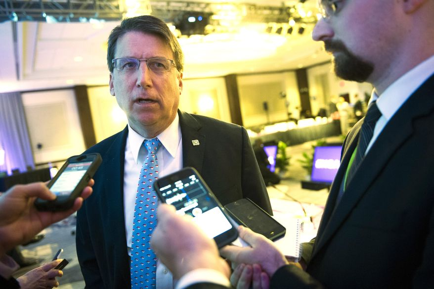North Carolina Gov. Pat McCrory speaks with reporters following the opening session of the National Governors Association Winter Meeting in Washington, Saturday, Feb. 20, 2016. (AP Photo/Cliff Owen) ** FILE **