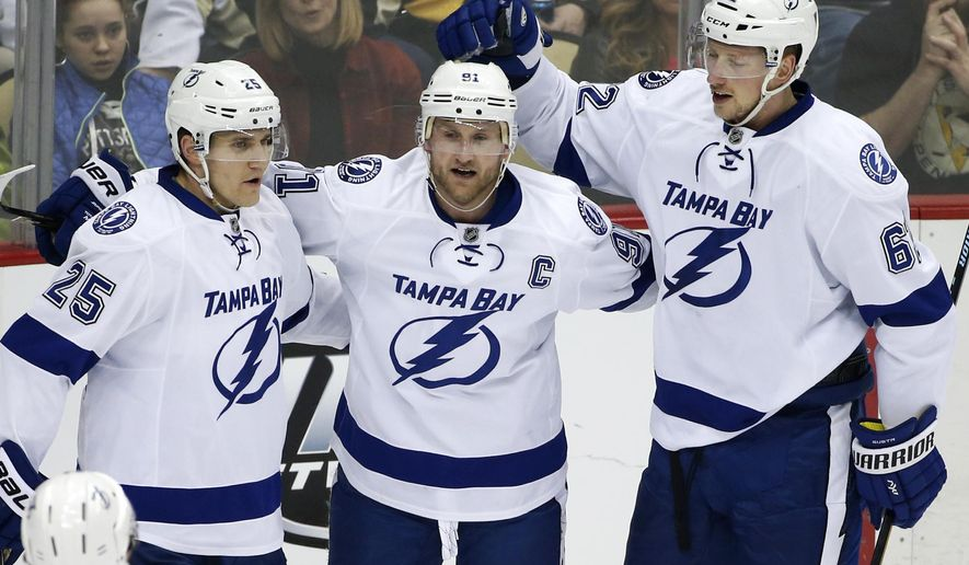 Tampa Bay Lightning's Steven Stamkos (91) celebrates his goal with teammates Matt Carle (25) and Andrej Sustr (62) during the first period of an NHL hockey game against the Pittsburgh Penguins in Pittsburgh, Saturday, Feb. 20, 2016. (AP Photo/Gene J. Puskar)