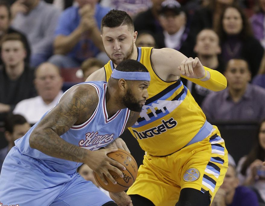 Sacramento Kings center DeMarcus Cousins, left, drives against Denver Nuggets center Jusuf Nurkic during the first quarter of an NBA basketball game Friday, Feb. 19, 2016, in Sacramento, Calif.( AP Photo/Rich Pedroncelli)