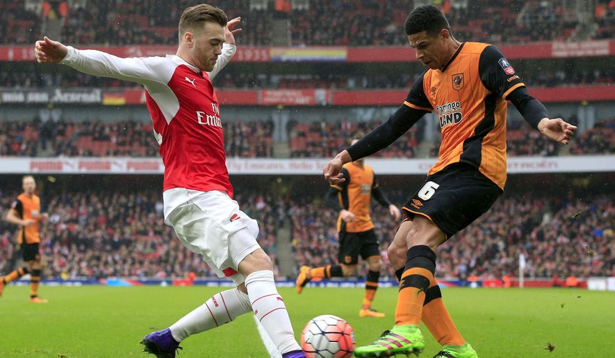 Hull City's Curtis Davies and Arsenal's Calum Chambers (left) battle for the ball during the English FA Cup, fifth round soccer match at The Emirates Stadium, London. PRESS ASSOCIATION Photo. Picture date: Saturday Feb. 20, 2016. Photo credit should read: (Jonathan Brady / PA via AP) UNITED KINGDOM OUT - NO SALES - NO ARCHIVES