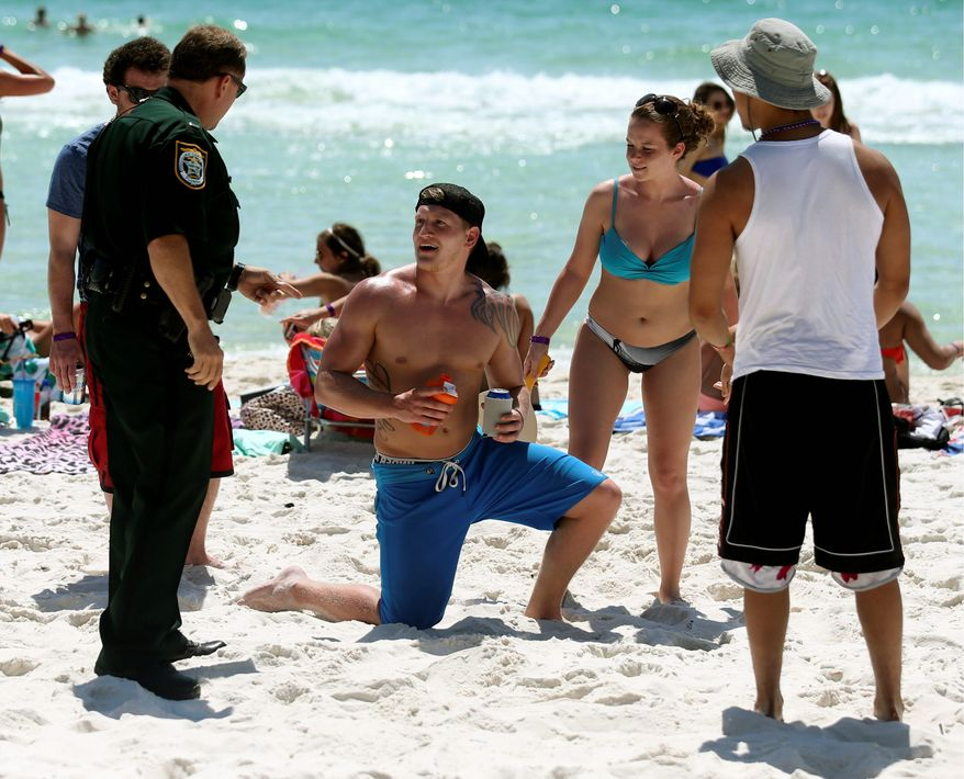 The biggest concern for businesses and residents is the monthlong ban of alcohol on the beach, which both the county and the city enacted. Several business owners, who packed city and county meetings during debate over the resolutions, told government representatives that the alcohol ban would cost them their jobs. ((PANAMA CITY, Florida) News Herald via Associated Press)