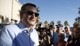 Republican presidential candidate, Sen. Ted Cruz, R-Texas, left, speaks with a supporter at a rally Sunday, Feb. 21, 2016, in Pahrump, Nev. (AP Photo/John Locher)