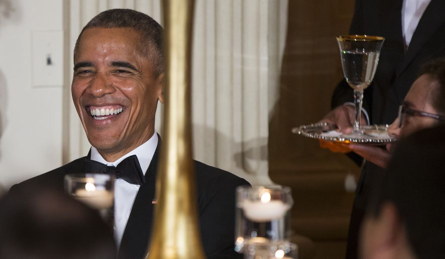 President Obama hosts the National Governors Association dinner at the White House on Sunday. (Associated Press)