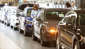 Volkswagen assembly workers are seen inspecting vehicles at the Volkswagen Leadership Visit on Jan. 14 in Chattanooga, Tenn. (Associated Press)