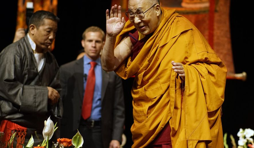 The Dalai Lama address the audience at the Minneapolis Convention Center on Sunday, Feb. 21, 2016 in Minneapolis.  The Dalai Lama arrived last month at Mayo Clinic in Rochester, Minn. He told the crowd he'd been receiving treatment for prostate problems. ( Richard Tsong-Taatarii/Star Tribune via AP)  MANDATORY CREDIT; ST. PAUL PIONEER PRESS OUT; MAGS OUT; TWIN CITIES LOCAL TELEVISION OUT