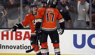 Anaheim Ducks defenseman Sami Vatanen, left, of Finland, congratulates Anaheim Ducks center Ryan Kesler (17) for scoring against the Calgary Flames during the second period of an NHL hockey game in Anaheim, Calif., Sunday, Feb. 21, 2016. (AP Photo/Alex Gallardo)