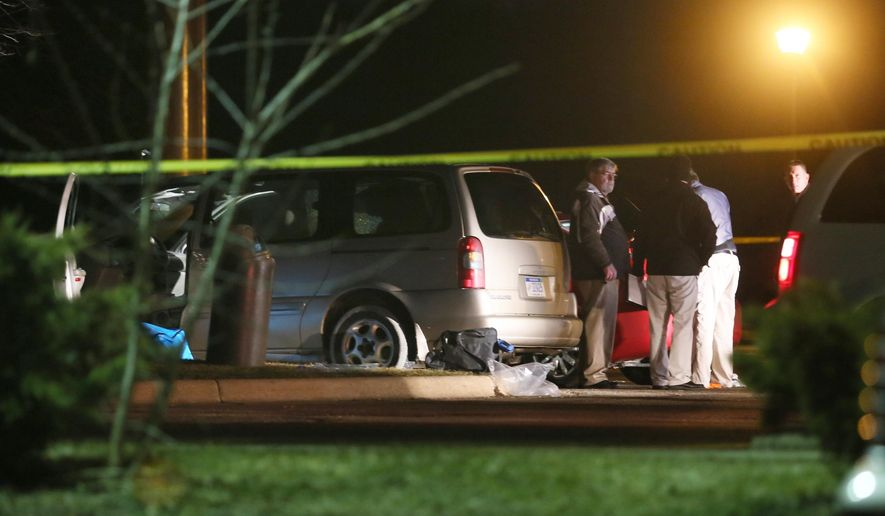 Police investigate the scene early Sunday, Feb. 21, 2016, where people were shot in vehicles outside a Cracker Barrel restaurant in Kalamazoo, Mich. A man drove around Kalamazoo shooting people at three locations Saturday, leaving six dead and three injured, two of them critically, police said. Police have arrested the suspect in the Saturday, Feb. 20, multiple shootings. (Mark Bugnaski/Kalamazoo Gazette) MANDATORY CREDIT