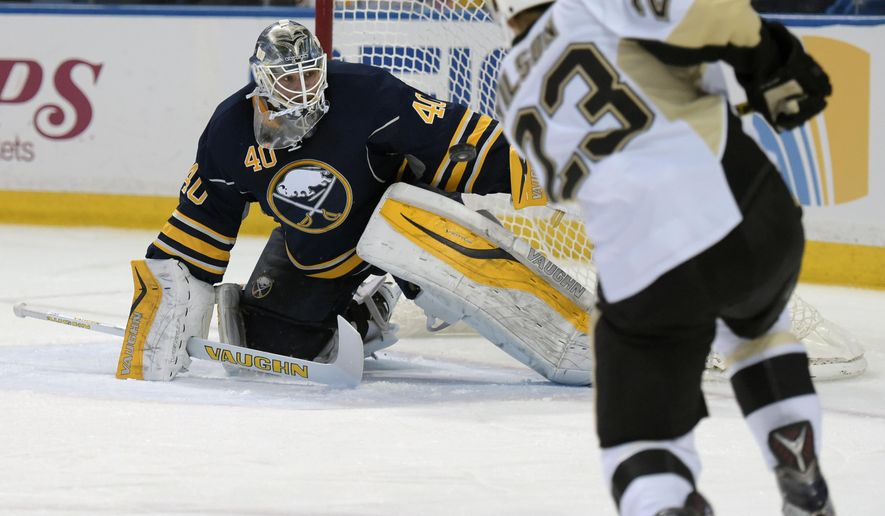 Pittsburgh Penguins left winger Scott Wilson (23) scores as Buffalo Sabres goaltender Robin Lehner (40) watches the puck during the second period of an NHL hockey game Sunday, Feb. 21, 2016, in Buffalo, N.Y. (AP Photo/Gary Wiepert)