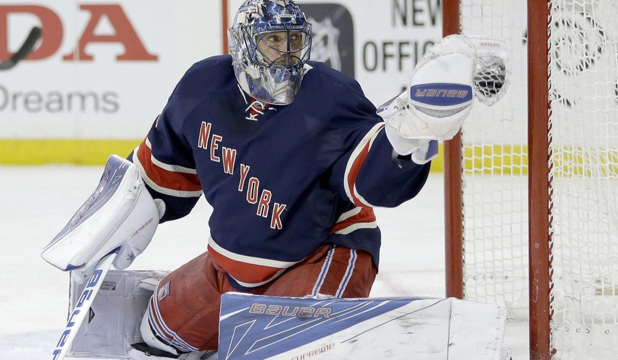 New York Rangers goalie Henrik Lundqvist makes a save during the first period of the NHL hockey game against the Detroit Red Wings, Sunday, Feb. 21, 2016, in New York. (AP Photo/Seth Wenig)