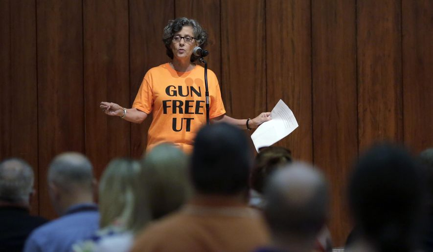 File - In this Sept. 30, 2015 file photo, professor Joan Neuberger speaks during a public forum at the University of Texas campus as a special committee studies how to implement a new law allowing students with concealed weapons permits to carry firearms into class and other campus buildings, in Austin, Texas. When Republicans in the Texas Legislature forced universities to open their classrooms and buildings to concealed handguns, they championed Constitutional rights and self-defense. But those ideals can't seem to get past the private school gates. (AP Photo/Eric Gay, File)