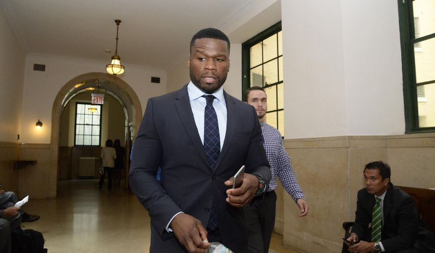FILE - In this July 21, 2015 file photo, Curtis Jackson, aka 50 Cent, appears in Manhattan Supreme Court in New York.  The rapper has been ordered to appear in bankruptcy court in Connecticut to explain photos showing him with wads of cash. Judge Ann Nevins told the rapper's lawyer Thursday, Feb. 18, 2016  that several photos posted on Instagram made her concerned about allegations 50 Cent wasn't being truthful about his finances. A hearing date hasn't been set.  (Jefferson Siegel/New York Daily News/Pool)