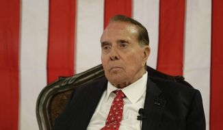 Former Kansas Sen. Bob Dole speaks during a campaign stop for Republican Sen. Pat Roberts at a mall Monday, Sept. 22, 2014, in Dodge City, Kan. (AP Photo/Charlie Riedel)