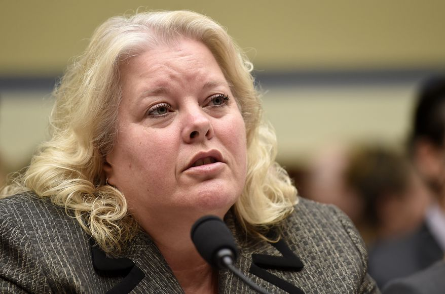 In this June 24, 2015, file photo, Office of Personnel Management (OPM) Chief Information Officer Donna K. Seymour testifies on Capitol Hill in Washington. Seymour has resigned days before a congressional oversight committee hearing on the breach. (AP Photo/Susan Walsh, File)