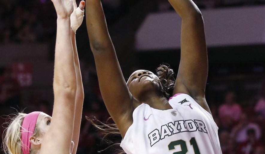 Baylor forward/center Kalani Brown (21) shoots in front of Oklahoma center McKenna Treece, left, in the second quarter of an NCAA college basketball game in Norman, Okla., Monday, Feb. 22, 2016. (AP Photo/Sue Ogrocki)