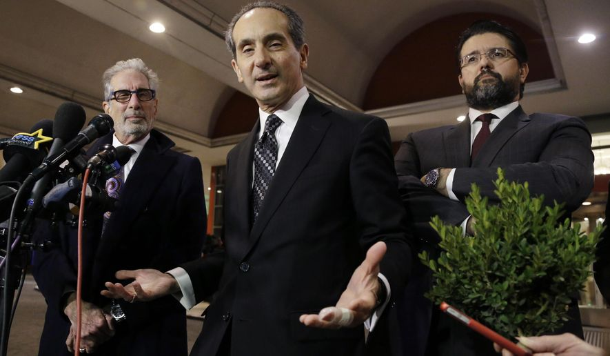 Plaintiffs attorney Joseph Cammarata, center, speaks as attorneys Ira Sherman, left, and Michael Bressler, right, listen during a news conference, Monday, Feb. 22, 2016, in Springfield, Mass. after a deposition of Camille Cosby, wife of Bill Cosby. Bill Cosby's wife finished hours of answering questions under oath in a Massachusetts defamation lawsuit filed against him by seven accusers. Camille Cosby has publicly stood by her husband despite the dozens of sexual-assault allegations against him. (AP Photo/Elise Amendola)