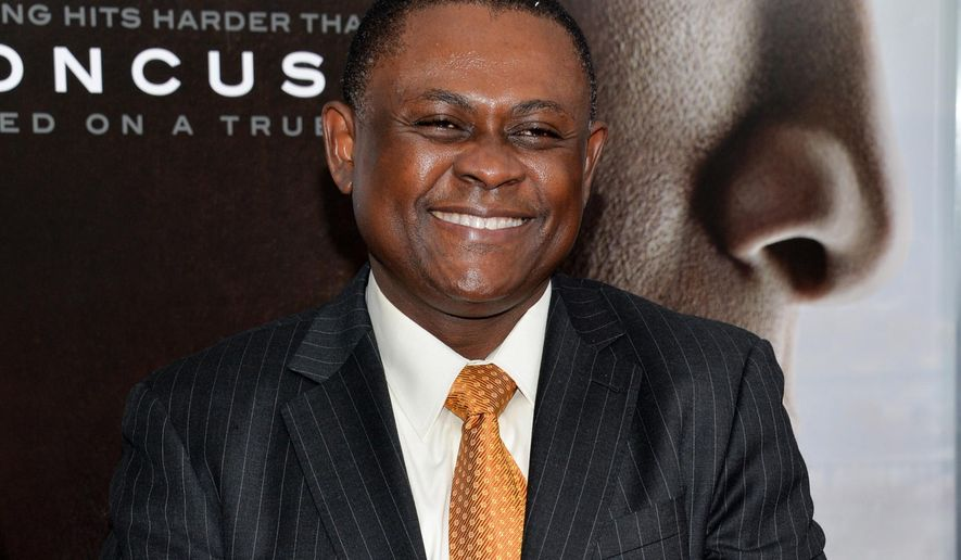 """FILE - In this Dec. 16, 2015 file photo, Dr. Bennet Omalu attends a special screening of """"Concussion"""" in New York. Omalu, forensic pathologist who identified the brain disease CTE afflicting numerous football players and was played by Will Smith in the movie """"Concussion,"""" has a six-figure deal with the Christian publisher Zondervan for a memoir. (Photo by Evan Agostini/Invision/AP, File)"""