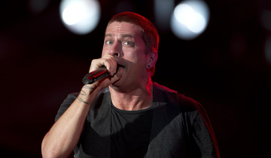 Rob Thomas of Matchbox Twenty performs during the annual Rock in Rio music festival in Rio de Janeiro, Brazil, in this Sept. 20, 2013, file photo. Matchbox Twenty frontman Thomas has apologized after being accused of making a racist joke during a solo concert in Australia. (AP Photo/Silvia Izquierdo, File)