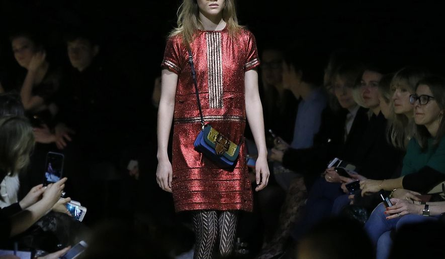 A model displays a design during the Burberry Autumn/Winter show at London Fashion Week, Monday, Feb. 22, 2016. As the fashion world comes to London for its semi-annual round of minutely choreographed catwalk shows, luxury designers are shaking up the traditional show and rethinking the way they reach customers to adapt to the age of social media and e-commerce. (AP Photo/Kirsty Wigglesworth)