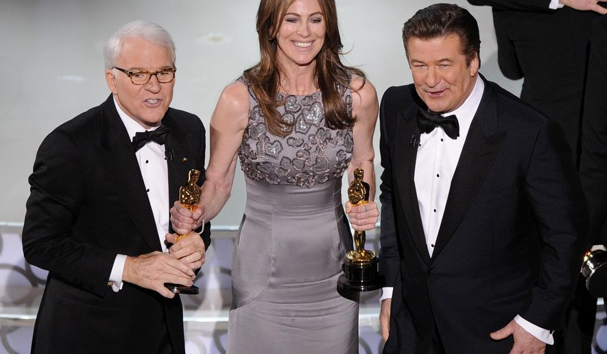 "FILE - In this March 7, 2010 file photo, director Kathryn Bigelow, center, holds her Oscars for best motion picture of the year and best achievement in directing for ""The Hurt Locker"" with hosts Alec Baldwin, right, and Steve Martin at the conclusion of the 82nd Academy Awards in Los Angeles. Bigelow was the first and only woman to win an Oscar for best director. (AP Photo/Mark J. Terrill, File)"