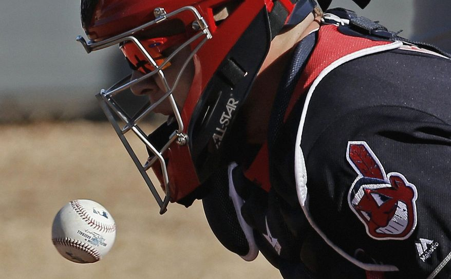 Cleveland Indians catcher Roberto Perez stops a ball during a spring training baseball workout Monday, Feb. 22, 2016, in Goodyear, Ariz. (AP Photo/Morry Gash)