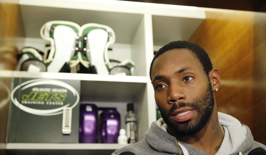 FILE - In this Dec. 30, 2015, file photo, New York Jets cornerback Antonio Cromartie speaks to reporters in front of his locker at the team's NFL football training facility in Florham Park, N.J.  The New York Jets have released cornerback Antonio Cromartie, a cost-cutting move that will save the team $8 million in salary cap space. The decision Monday, Feb. 22, 2016,  marks the second time in three years that the Jets have cut Cromartie, who was re-signed last offseason after a year in Arizona. (AP Photo/Kathy Willens, File)