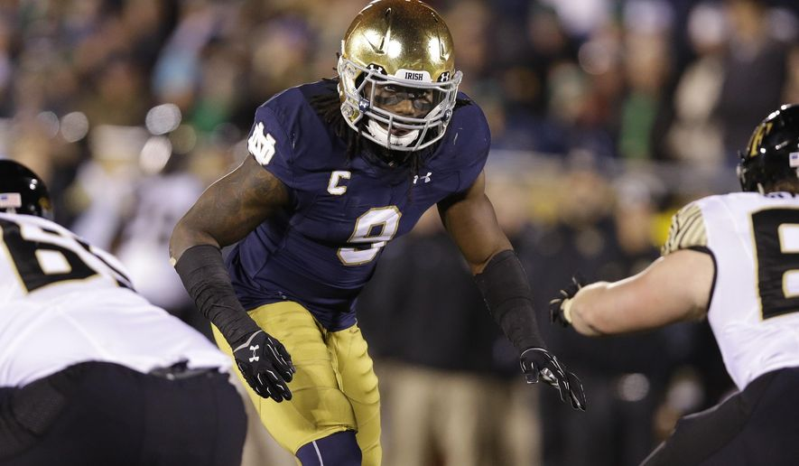 FILE - In this Nov. 14, 2015, file photo, Notre Dame linebacker Jaylon Smith (9) is shown during an NCAA college football game against Wake Forest in South Bend, Ind. Football fans see the NFL's annual scouting combine as merely a numbers game that comes down to the times, jumps and drills they see on television. NFL executives are more interested in getting behind-the-scenes answers through medical checks and personal interviews. (AP Photo/Michael Conroy, File)