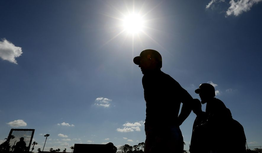 Pittsburgh Pirates players prepare to take batting practice during a spring training baseball workout Saturday, Feb. 20, 2016, in Bradenton, Fla. (AP Photo/Chris O'Meara)