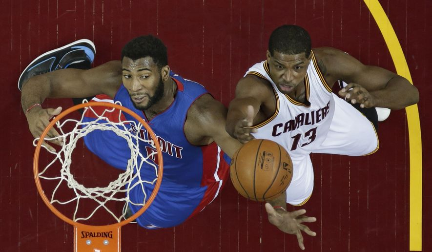 Cleveland Cavaliers' Tristan Thompson, right, drives to the basket against Detroit Pistons' Andre Drummond in the first half of an NBA basketball game Monday, Feb. 22, 2016, in Cleveland. (AP Photo/Tony Dejak)