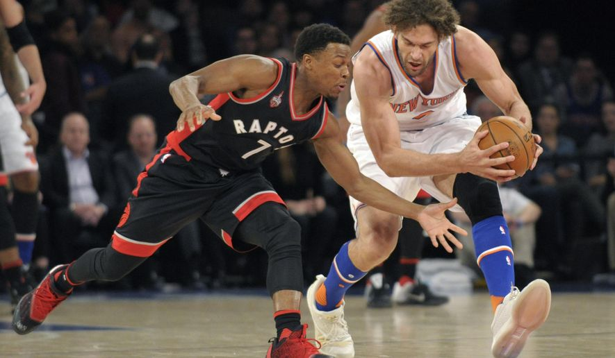 New York Knicks center Robin Lopez, right, beats Toronto Raptors guard Kyle Lowry to the ball during the first quarter of an NBA basketball game Monday, Feb. 22, 2016, at Madison Square Garden in New York. (AP Photo/Bill Kostroun)