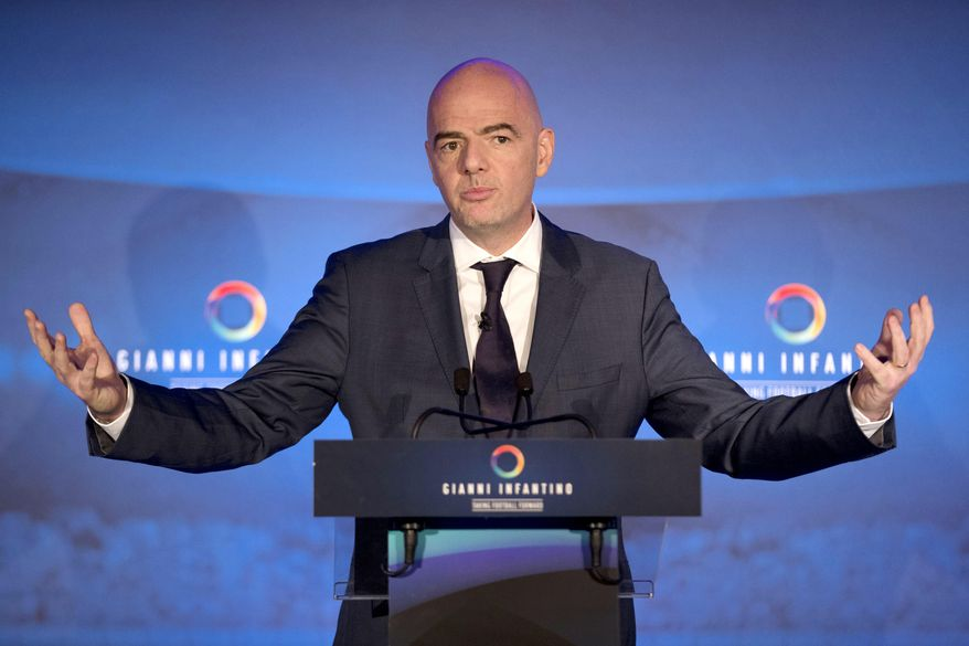 FILE - In this Feb. 1, 2016 file photo FIFA Presidential Candidate Gianni Infantino speaks to the media as he unveils his 90 day plan that he will implement if he is elected FIFA President, at Wembley Stadium in London. Infantino is one of the five candidates to succeed Sepp Blatter as FIFA President on Friday, Feb. 26, 2016 when soccer's scandal-scarred world body picks a new president after nine months of crisis.  (AP Photo/Matt Dunham, file)