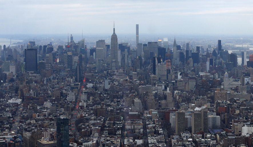 A super slim skyscraper at 432 Park Avenue competes with the Empire State building as it juts above the Manhattan skyline as seen from the One World Observatory, Wednesday, Feb. 17, 2016, in New York. (AP Photo/Julie Jacobson)